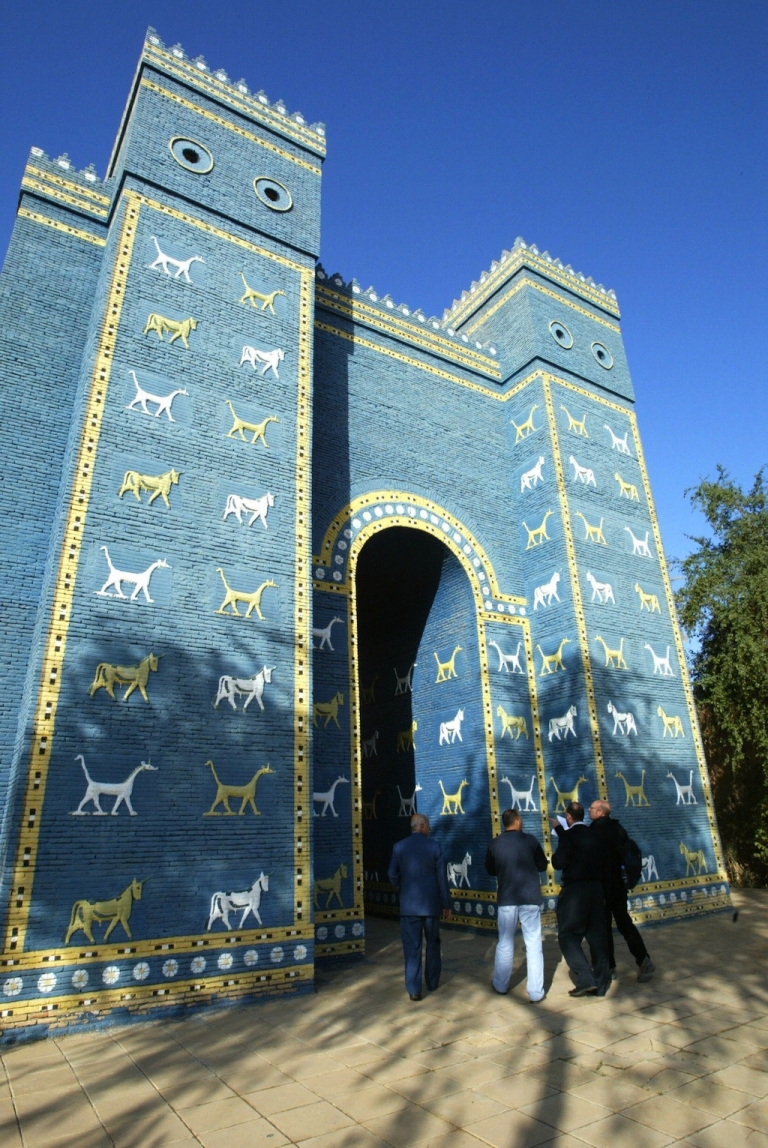 <p>Visitors walk through the newly renovated Ishtar Gate in ancient Babylon, some 100 kms south of Baghdad, on November 27, 2008. Fragments of bricks, engraved with cuneiform characters thousands of years old, lie mixed with the rubble and sandbags left by the US military on the ancient site of Babylon in Iraq. Archaeologists say a year of terracing work and 18 months of military presence, with tanks and helicopters, have caused irreparable damage to one of the cradles of civilisation.</p>