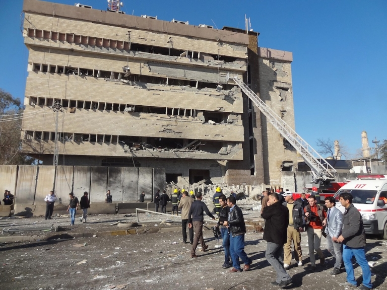 <p>Rescuers work at the scene after a car bombing followed by an assault on a police headquarters in a disputed northern city of Kirkuk, on Feb. 3, 2013.</p>