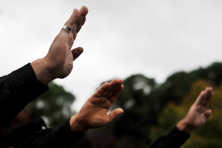 <p>Far-right militants make the fascist salute during a rally in Italy on Oct. 28, 2012.</p>