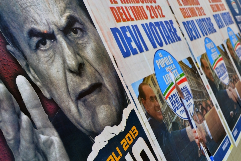 <p>Italian electoral placards showing political rivals Pier Luigi Bersani, left, and Silvio Berlusconi. The sworn enemies may end up sharing control of the country.</p>