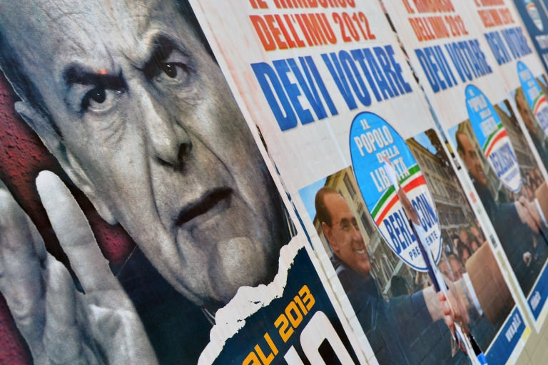 <p>Election posters in Rome showing Democratic Party leader Pier Luigi Bersani (L) and right-wing Silvio Berlusconi. Italy is at an impasse after elections failed to produce a clear winner.</p>