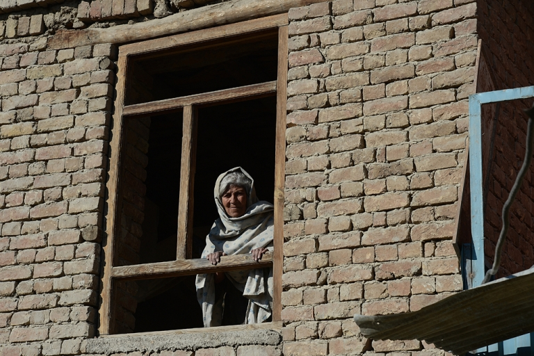 <p>An elderly Afghan woman looks through the window of her house after a clash between Afghanistan forces and Taliban fighters in Kabul on Jan. 21, 2013. As the US and allies focus on fighting in the countryside, parts of the Afghan capital have slipped unnoticed into lawlessness.</p>