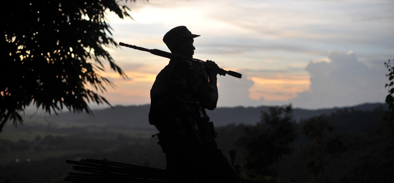 <p>A soldier from the All Burma Students Democratic Front - Northern Burma (ABSDF-NB), an ally of the Kachin Independence Army (KIA), holds his weapon as he looks out from an outpost on the Laja Yang front-line in Myanmar's northern Kachin state, home to the ethnic Kachin rebels' headquarters.</p>