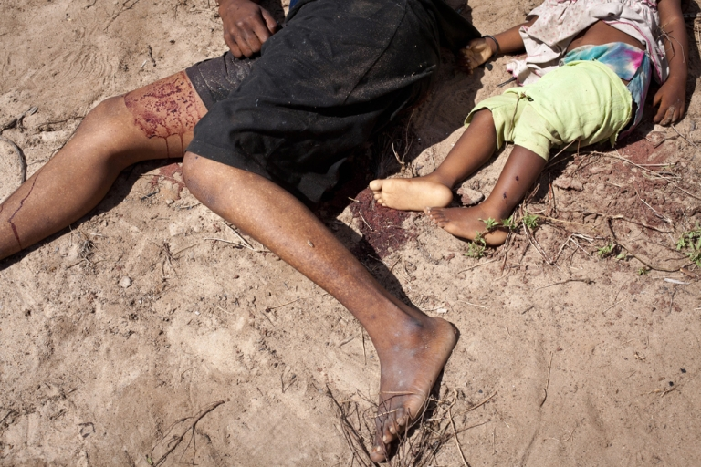 <p>The body of a woman and her daughter lie on the ground following an overnight attack on Jan. 10, 2013 on the village of Kibusu in the Tana river Delta region.</p>