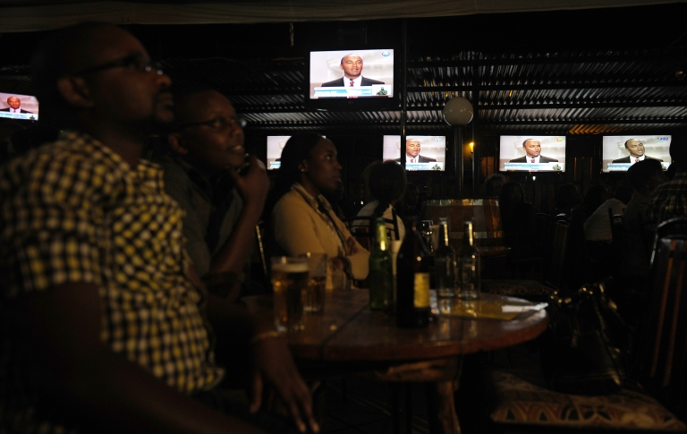 <p>Kenyans in Nairobi watch the country's first-ever presidential debate on Feb. 11, 2013.</p>