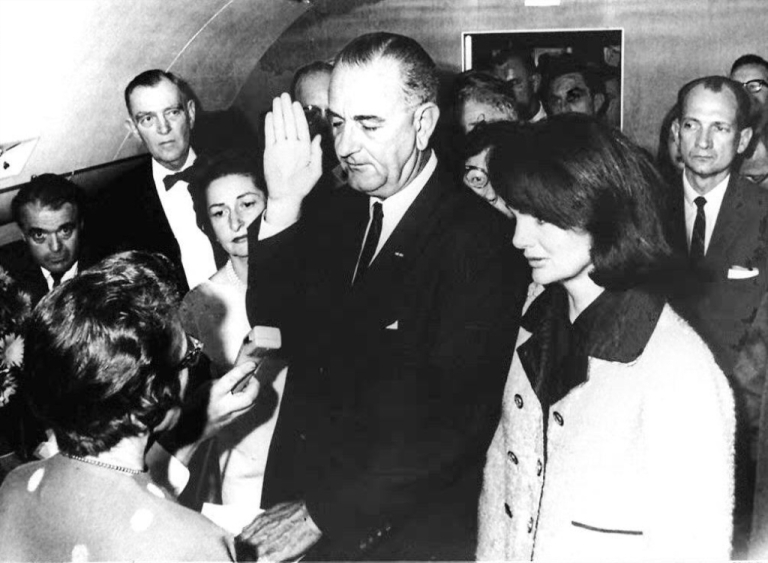 <p>In this 22 November 1963 file photo, Jacqueline Kennedy Onassis (R) and Lady Bird Johnson (2ndL), watch as US Vice President Lyndon Johnson (C) is administered the oath of office by Federal Judge Sarah Hughes (L) as he assumed the presidency of the US following the assassination of President John F. Kennedy in Dallas, Texas.</p>