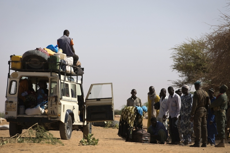 <p>Malian people are controlled by Malian soldiers at a check point on February 23, 2013 in the center of northern Mali's largest city of Gao. Fresh fighting erupted in northern Mali, security sources told, the latest unrest to hit the area in the wake of a French-led campaign that drove radical Islamist fighters from major cities.</p>