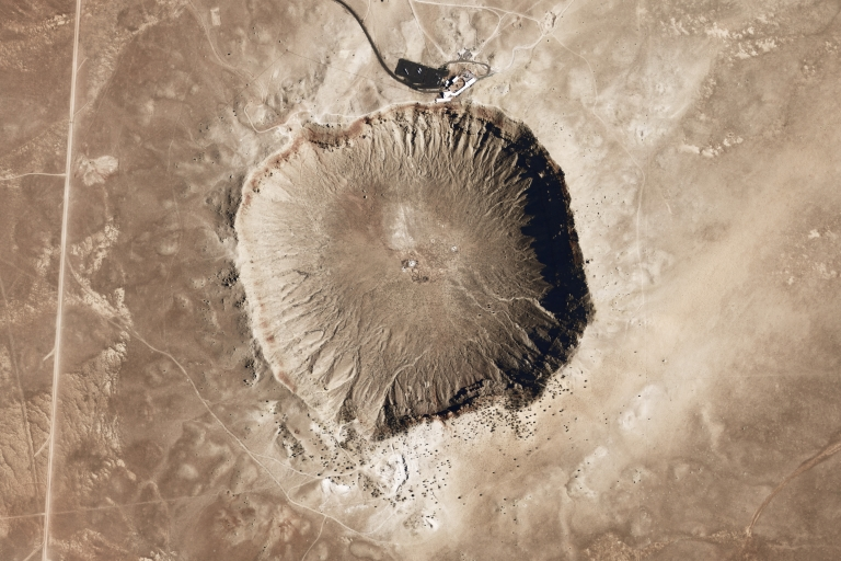<p>Meteor Crater in Arizona formed from the impact of an iron-nickel asteroid about 46 meters (150 feet) across.</p>