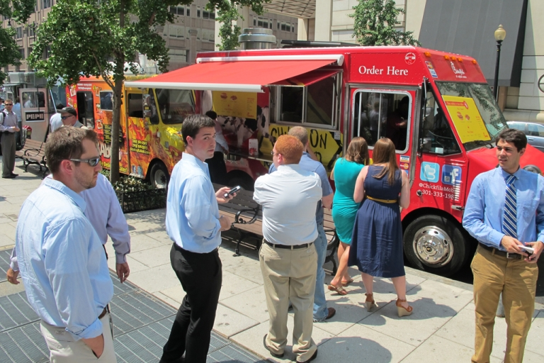 <p>Customers line up at a Chick-fil-A food truck in Washington, DC, on July 26, 2012. Taking note of the explosive growth of food trucks, more small businesses are forgoing physical office space and instead running startups from their cars.</p>