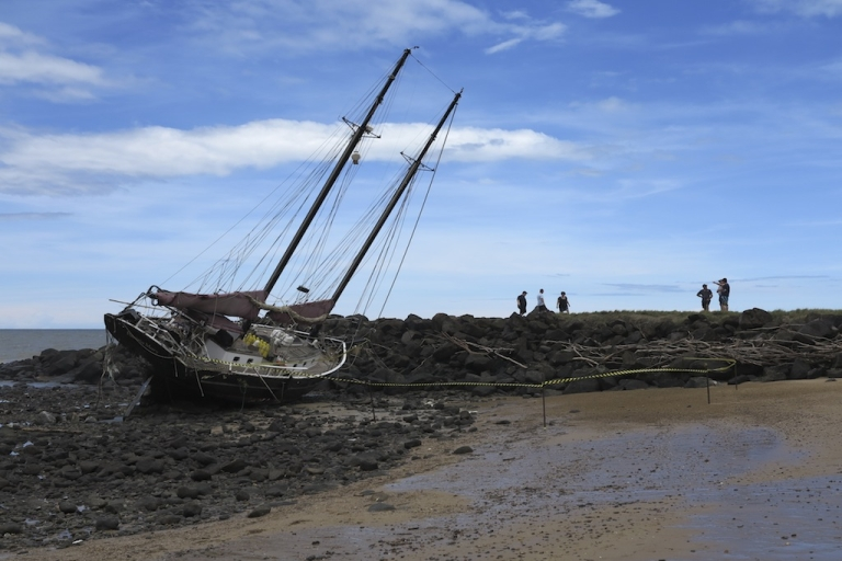 <p>This picture taken on Jan. 28, 2013 shows the twin masted yacht the 'Patricia Mary' washed up on Baraga beach in Bundaberg after the passing of tropical cyclone Oswald.</p>