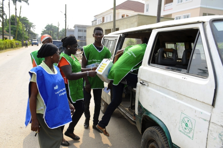 <p>Health workers board a vehicle that will take them to polio vaccination centers in Lagos, Nigeria.</p>