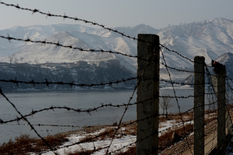 <p>View of the North Korean town of Supung across the Yalu River from the Chinese town of Xiejiagou on February 9, 2013.</p>