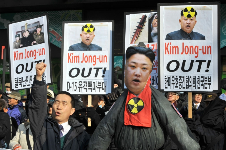 <p>South Korean activists shout slogans behind an effigy of North Korean leader Kim Jong-Un during a rally denouncing North Korea's nuclear test, in Seoul on February 13, 2013.</p>