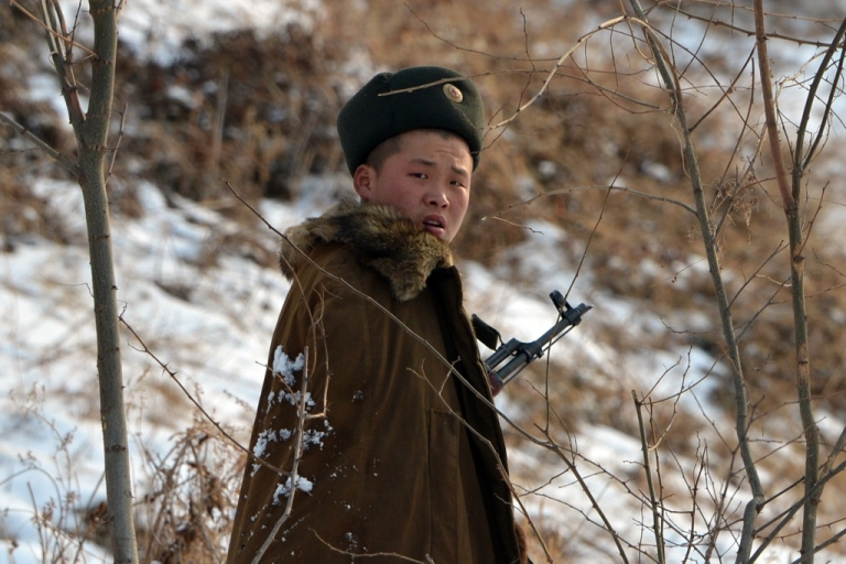 <p>A North Korean soldier patrols along the Yalu River near the North Korean town of Sinuiju across from the Chinese city of Dandong, after the country conducted its third nuclear test on Feb. 12.</p>