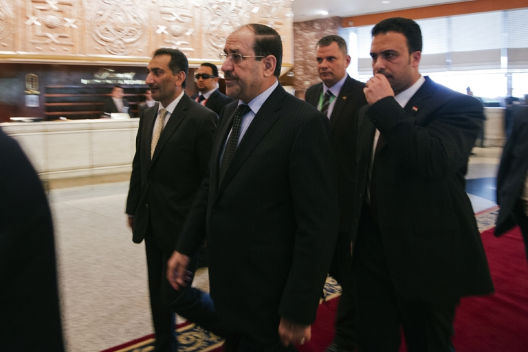 <p>Iraq Prime Minister Nouri al-Maliki (C) arrives to attend the 12th summit of the Organisation of Islamic Cooperation on February 6, 2013, in Cairo.</p>