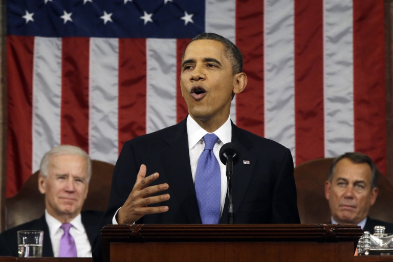 <p>US President Barack Obama, flanked by Vice President Joe Biden and House Speaker John Boehner (R-Ohio), delivers his State of the Union speech before a joint session of Congress at the US Capitol Feb. 12, 2013, in Washington, DC. Facing a divided Congress, Obama focused his speech on new initiatives designed to stimulate the US economy.</p>