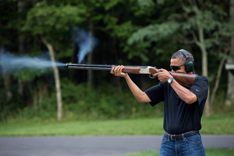 <p>President Barack Obama fires a gun during target practice at Camp David on Aug. 4, 2012 in this White House photo. The administration released the photo on Feb. 2, 2012 in response to critics who doubted if POTUS had ever held a weapon.</p>