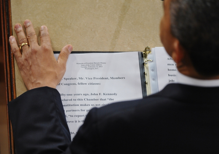 <p>President Barack Obama rests his hand next to a copy of his speech as he delivers his State of the Union address before a joint session of Congress on February 12, 2013 at the US Capitol in Washington, DC.</p>