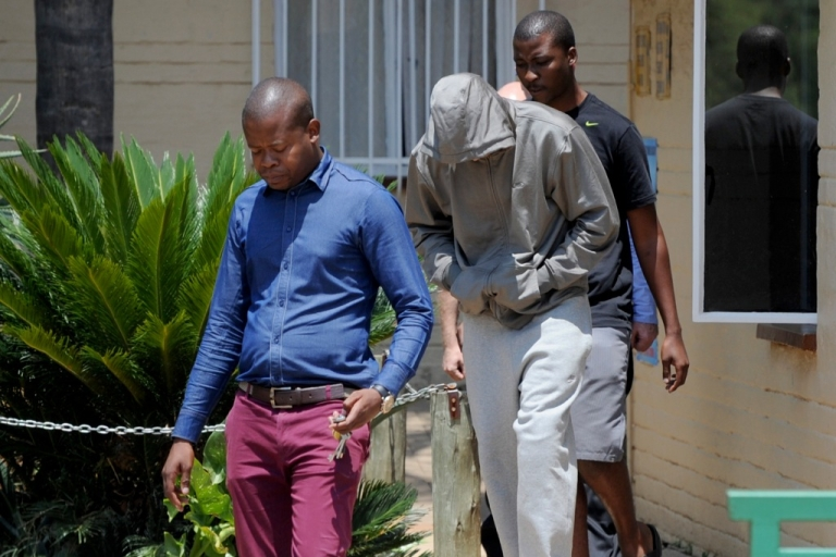 <p>South Africa's Olympic sprinter Oscar Pistorius leaves the Boshkop police station on February 14, 2013 in Pretoria East, to be taken into police custody after allegedly shooting dead his model girlfriend.</p>