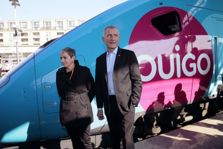 <p>France's national rail company SNCF head, Guillaume Pepy (R) and Valerie Dehlinger (G) director of the 'Ouigo' project, pose in front of the new low-cost TGV high-speed train 'Ouigo' at the Gare de Lyon railway station in Paris on Feb. 19, 2013</p>
