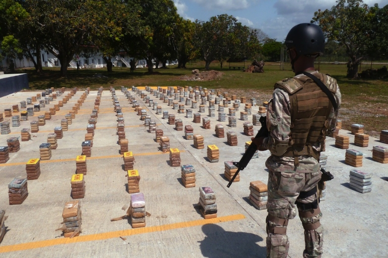 <p>A member of the National Air and Navy Service of Panama guards a 1305 kg cocaine consignment seized in Cocoli, Panama on Jan. 23, 2013.</p>