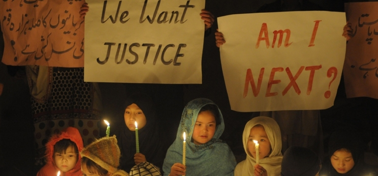 <p>Pakistani Shiite Muslim children hold candles on Feb. 21, 2013 during a vigil at the site of a bomb attack in Quetta.</p>