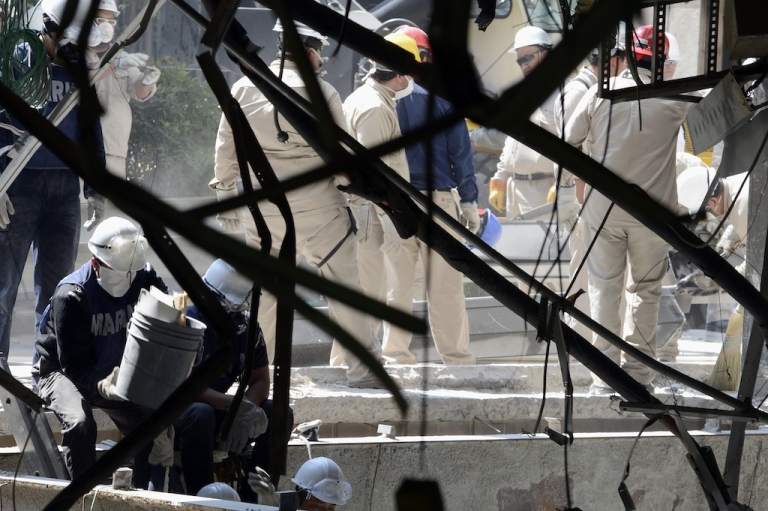 <p>Workers at the damaged Pemex building in Mexico City on Tuesday. The force of the explosion collapsed three floors of the more than 50-story tower.</p>