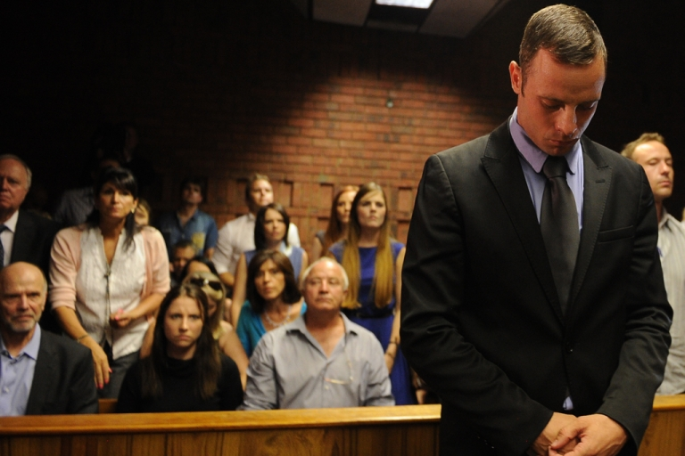 <p>South African Olympic sprinter Oscar Pistorius appears on Feb. 21, 2013, at the Magistrate Court in Pretoria, South Africa. After four days of combative hearings, a South African magistrate on Friday granted bail for Oscar Pistorius, the double amputee accused of murdering his girlfriend Reeva Steenkamp.</p>