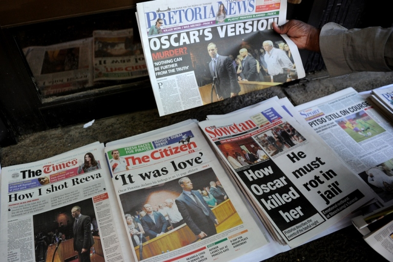 <p>Front pages of South African newspapers featuring Olympic sprinter Oscar Pistorius' Feb. 19 court appearance are displayed on February 20, 2013 outside the Magistrate Court in Pretoria. Pistorius battled on Feb. 20 to secure bail as he appeared on charges of murdering his model girlfriend Reeva Steenkamp on Feb. 14, Valentine's Day. South African prosecutors argue that Pistorius is guilty of premeditated murder in Steenkamp's death, a charge which could carry a life sentence.</p>