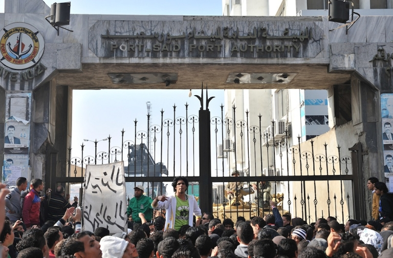 <p>Thousands of Egyptians protest and close down government offices and factories in the Suez Canal city of Port Said on Feb. 17, 2013.</p>