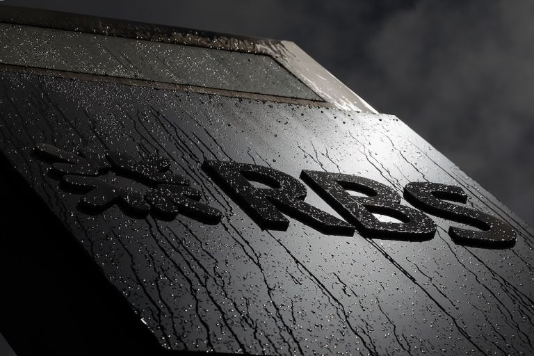 <p>The Royal Bank of Scotland (RBS) logo is covered in raindrops outside their building on Bishopsgate on August 3, 2012 in London, England. The bank is the latest to be fined over its involvement in the LIBOR rate-fixing scandal.</p>