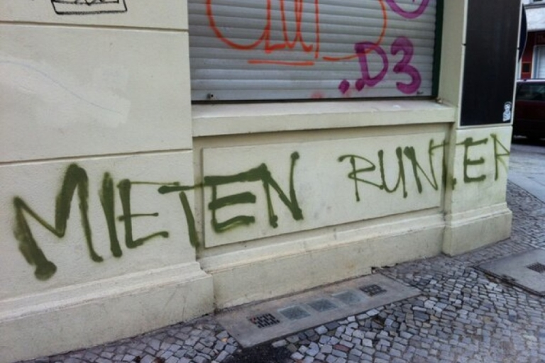 <p>Hipsters aren't always welcome in Neukölln, Berlin — especially when they're willing to pay higher rent. This graffiti says 'rents down.'</p>