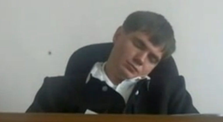 <p>Russian judge Yevgeny Makhno allegedly catching some shuteye during a trial.</p>