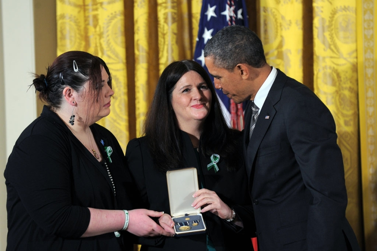 <p>US President Barack Obama presents a 2012 Citizens Medal to the family of slain Sandy Hook Elementary School teacher's aide Rachel Davino on February 15, 2013 during a ceremony in the East Room of the White House in Washington.</p>