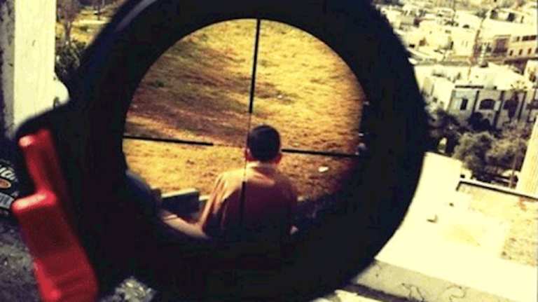 <p>A screengrab a photo that appears to show a Palestinian boy in the crosshairs of a sniper's rifle, reportedly taken by Israeli Defense Forces soldier Mor Ostrovski, who claims he found the photo on the internet.</p>