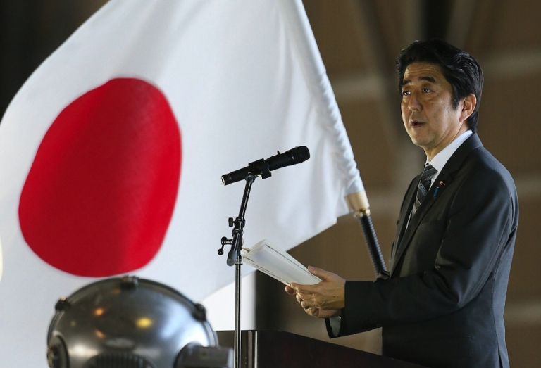 <p>Japanese Prime Minister Shinzo Abe delivers a speech upon his arrival at Naha air base in Japan's southern island of Okinawa on Feb. 2, 2013.</p>