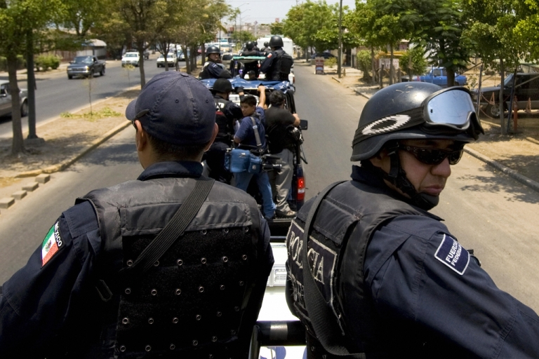 <p>Members of the Mexican Federal Police patrol the city of Culiacan, a northwestern city in Mexico's Sinaloa state, on May 28, 2008. State and Federal police rescued a group of 73 migrants in the city of Reynosa near the Texas border.</p>