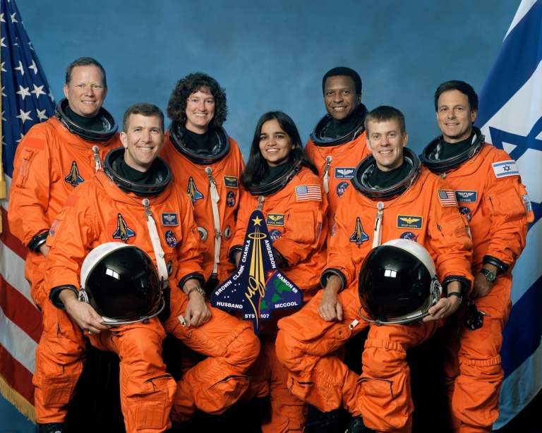 <p>The crew of Space Shuttle Columbia's mission STS-107 pose for the traditional crew portrait. Seated in front are astronauts Rick D. Husband (L), mission commander; Kalpana Chawla, mission specialist; and William C. McCool, pilot. Standing are (L to R) astronauts David M. Brown, Laurel B. Clark, and Michael P. Anderson, all mission specialists; and Ilan Ramon, payload specialist representing the Israeli Space Agency.</p>