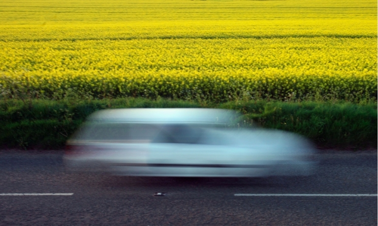 <p>Frank Lecerf was driving along in France's Pont-de-Metz when his car brakes malfunctioned, leaving him speeding at 125 mph for a full hour. Here, a car passes by a field of Oilseed Rape plants in bloom in the Cotswolds village of Tormarton on May 6, 2008 near Tetbury in Gloucestershire, England.</p>