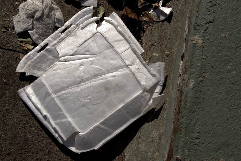 <p>Used Styrofoam containers are seen on the streets of Oakland, Calif.</p>