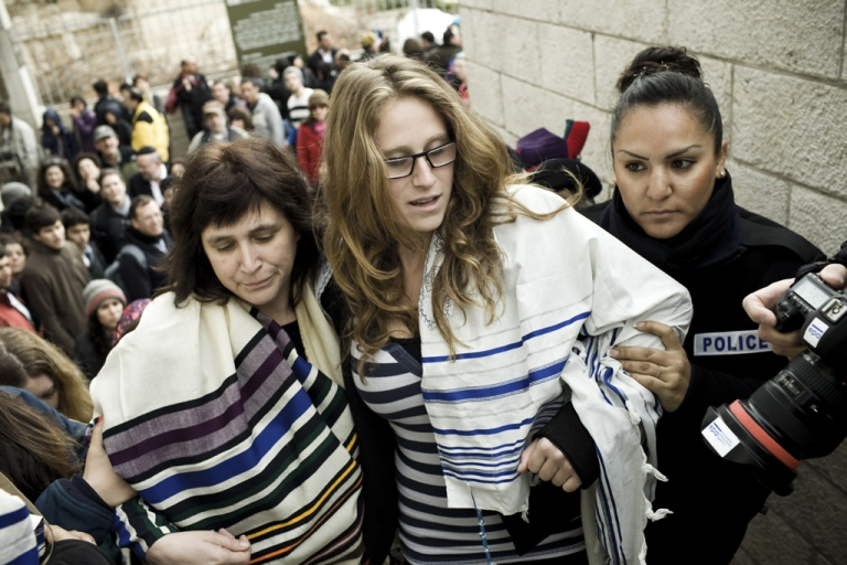 <p>Israeli police arrest American Rabbi Susan Silverman (left), sister of comedian Sarah Silverman, and her teenage daughter Hallel Abramowitz (center), after performing Rosh Hodesh prayers at the Western Wall in Jerusalem, on Feb. 11, 2013.</p>