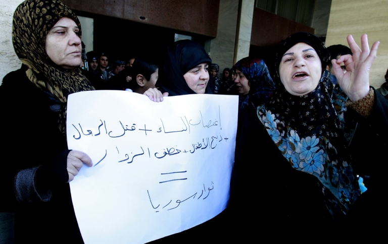 <p>Relatives of Lebanese Shiite pilgrims kidnapped last May in Syria hold a placard and shout slogans during a protest in front of the Qatari embassy in Beirut on Jan. 10, 2013. A group of about 50 demonstrators picketed the embassy of Qatar, which backs Syria's anti-regime rebels.</p>