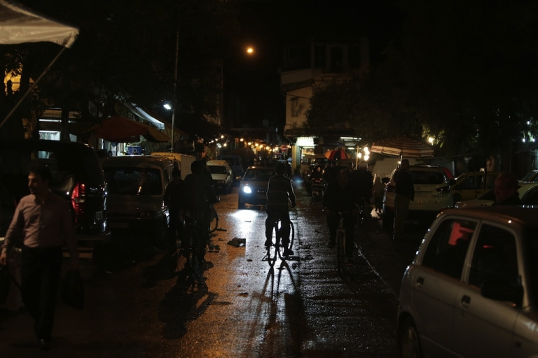<p>A general view shows Syrians shopping on a street in Damascus at night on November 11, 2012.</p>