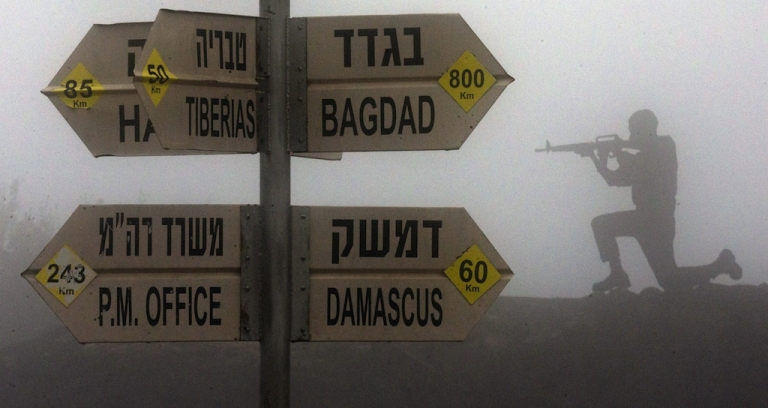 <p>A sculpture of an Israeli soldier standing guard is seen next to a sign for tourists showing the different distances to Jerusalem, Baghdad, Damascus and other locations, at an army post in Mount Bental in the annexed Golan Heights on January 31, 2013. Iran's deputy foreign minister said that the alleged Israeli air strike on a Syrian military research facility a day earlier will have 'grave consequences.'</p>