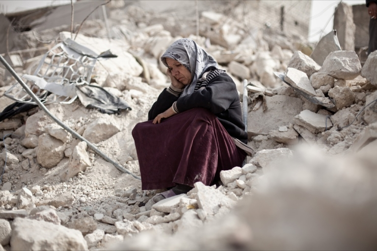 <p>Syrian Zakia Abdullah sits on the rubble of her house in the Tariq al-Bab district of the northern city of Aleppo on Feb. 23, 2013.</p>