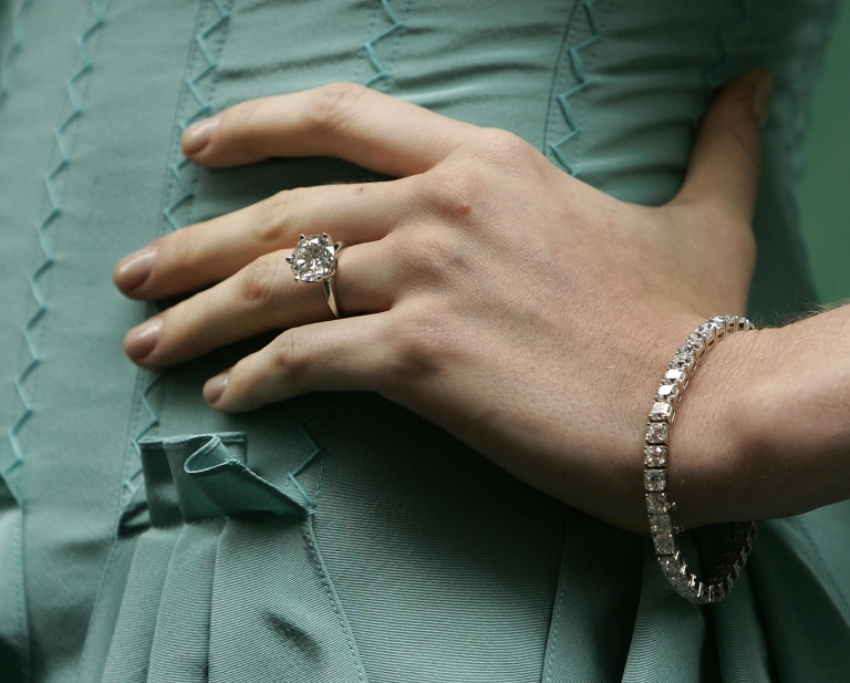 <p>A model shows off a diamond ring and bracelet outside the entrance to Tiffany &amp; Co.'s Wall Street store on Oct. 10, 2007.</p>