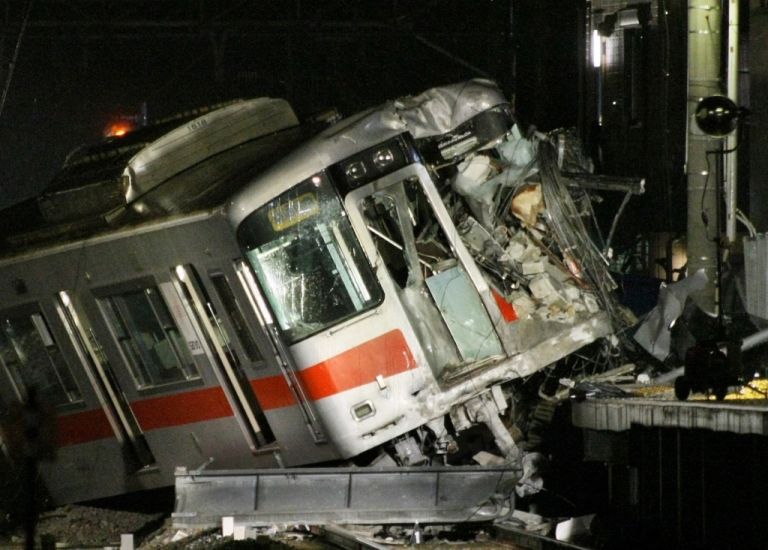 <p>A passenger train of the Sanyo Electric Railway is derailed after the train hit a truck at a level crossing in Takasago city in Hyogo prefecture, western Japan on February 12, 2013. An express passenger train hit a truck at a level crossing in Japan on February 12, police said, with footage and reports from the scene showing it had mounted a station platform.</p>