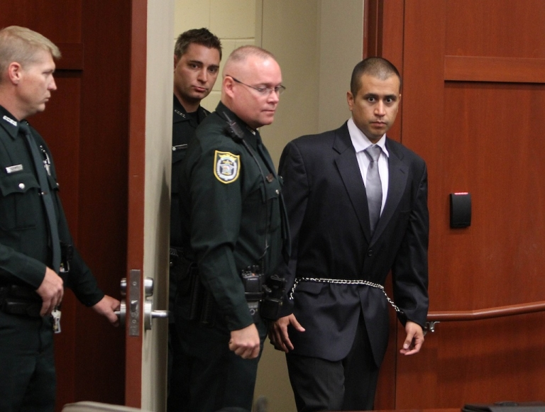 <p>George Zimmerman (R) enters into the courtroom of Circuit Judge Kenneth Lester on April 20, 2012, in Sanford, Florida.</p>