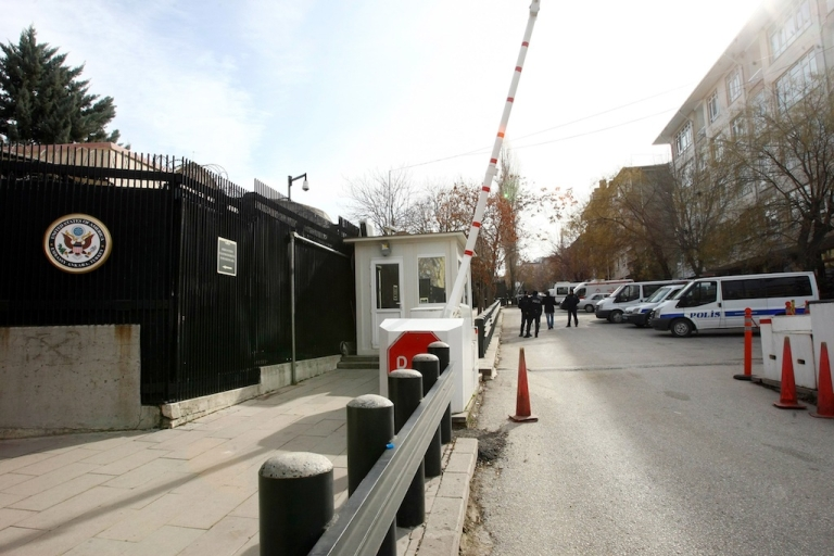 <p>Turkish policemen patrol outside the US Embassy in Ankara, a day after a leftist suicide bomber in Ankara, on February 2, 2013. Two security guards were killed in the blast outside the US embassy, local television reported, amid speculation it was a suicide attack. The force of the explosion damaged nearby buildings in the Cankaya neighborhood where many other state institutions and embassies are also located.</p>
