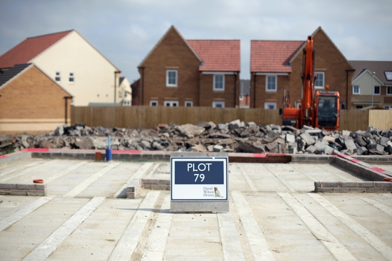 <p>A sign marks the plot for a new home being constructed on a residential housing estate on the edge of Bridgwater on Sept. 3, 2012 in Somerset, England.</p>